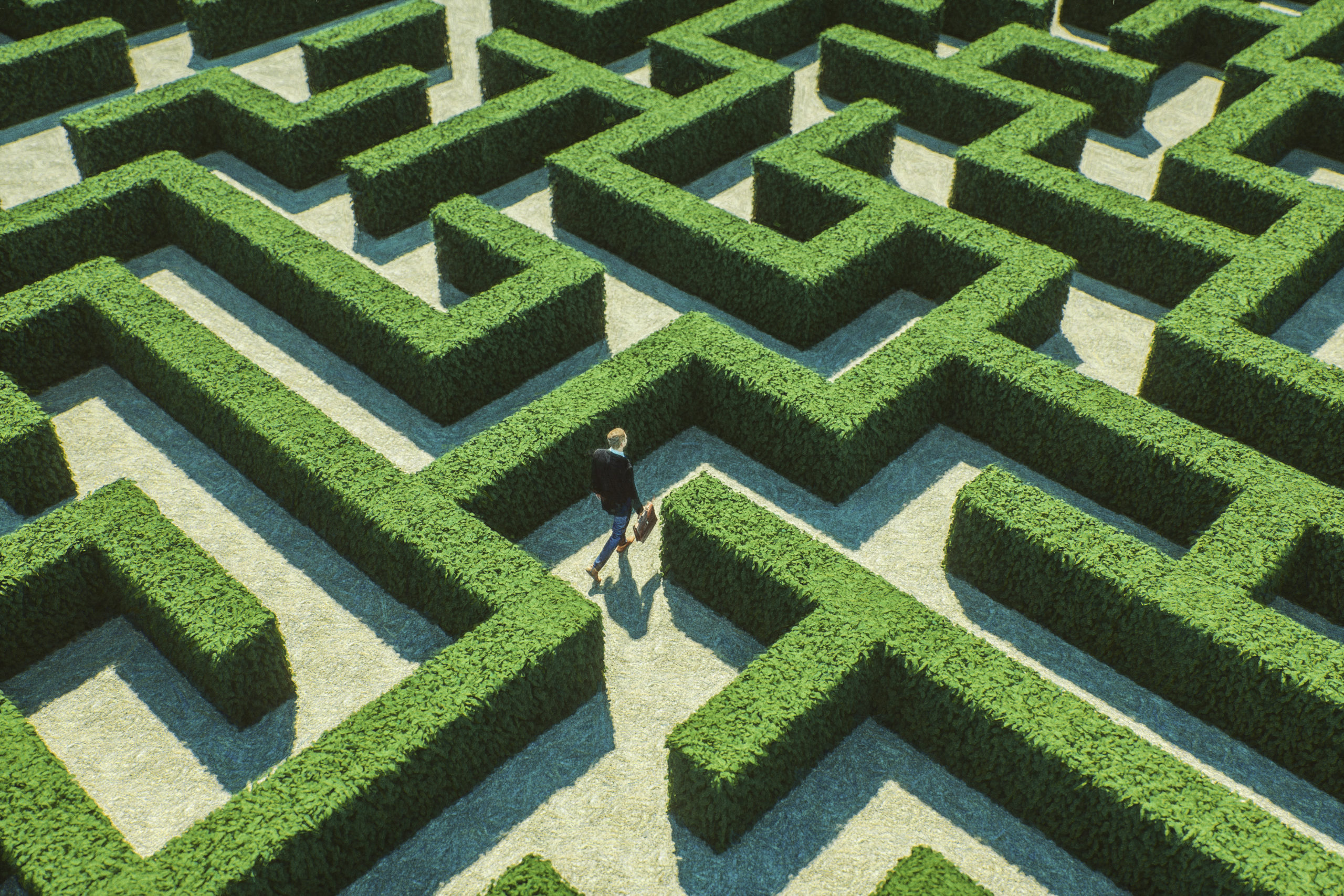 Businessman walking in maze